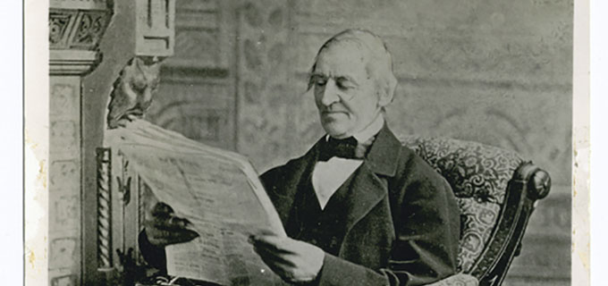 "von Photographer unidentified [Public domain], <a href=""http://commons.wikimedia.org/wiki/File%3AEmerson_reading_newspaper.jpg"">via Wikimedia Commons</a>"